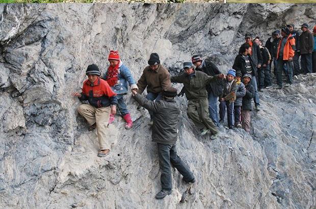80 school children make embark on a treacherous 125-mile journey through the frigid Xinjian Ulghur mountains to get home