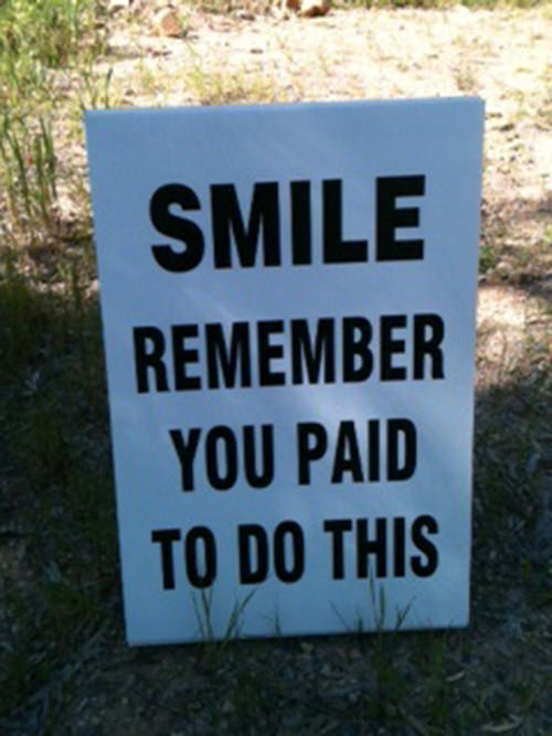 Funniest Running Signs #i: SMILE. Remember you paid to do this.
