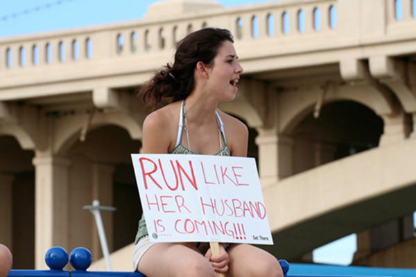 Funniest Running Signs #i: Run like her husband is coming.