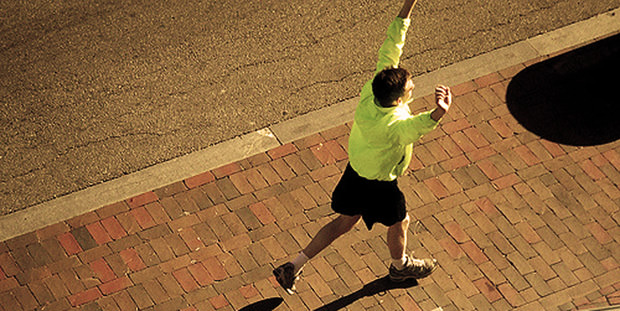 Runner With Arms Raised