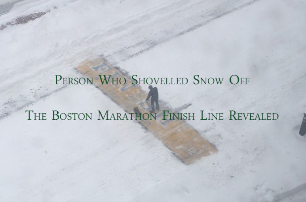 Man Shovelling Snow Off Finish Line of the Boston Marathon