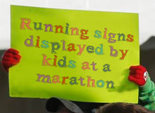 Running Signs Displayed By Kids At A Marathon