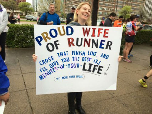 Sexy Running Signs At A Road Race #7: Proud wife of runner. Cross that finish line and I'll give you the best 13.1 minutes of you life. 10.1 more than usual.